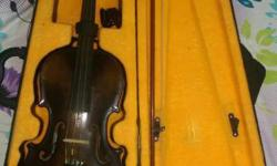 Violin with tuner, good condition.