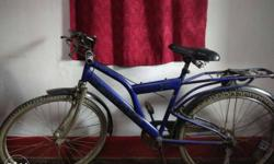 Blue ranger bicycle. Negotiable. Only tyre is puncture,