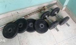 Four Black 2kg rubber weights and four 1kg rubber