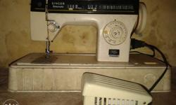 White An Black Singer Sewing Machine