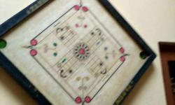 White And Black Wooden Carrom Board