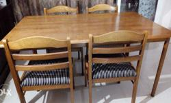 Wooden dining table with 6 chairs, condition of table