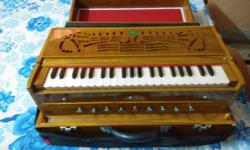 It's a box harmonium. I have bought this 7 months ago..