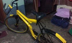 Yellow and black coloured bike