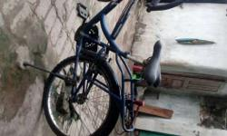 Hercules. Yellow And Blue Cruiser Bicycle. Tayer akdam