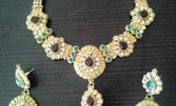 Ethnic necklace set with earrings from Zaveri Pearls.